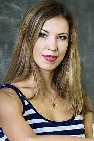 Russian girl Ekaterina,35 years old with blue eyes and light brown hair.