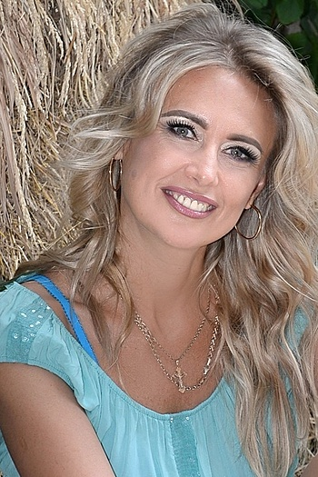 Elena age 49